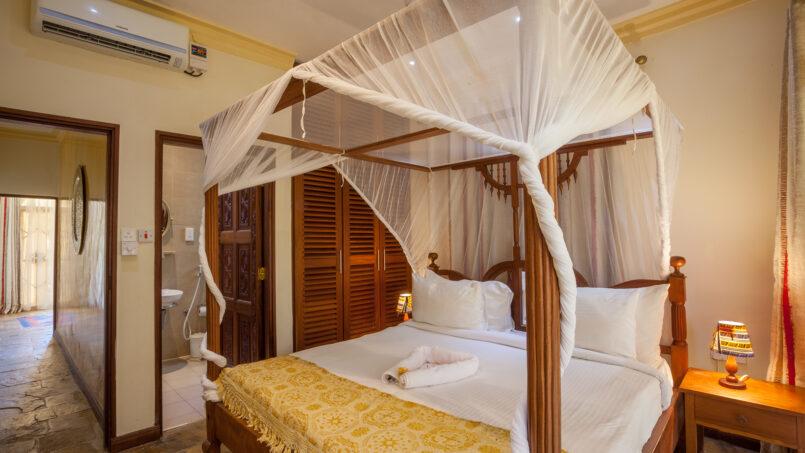 Amani Luxury Apartments Diani ensuite bedroom